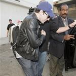 Sacha Baron Cohen and Isla Fisher arrive at LAX with daughter Olive 42897