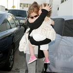 Sacha Baron Cohen and Isla Fisher arrive at LAX with daughter Olive 42893