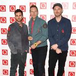Chris Martin with Guy Berryman and Jonny Buckland at the Q Awards in London  97007