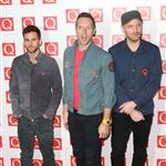 Chris Martin with Guy Berryman and Jonny Buckland at the Q Awards in London  97008