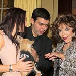 Joan Collins blessing puppies  51529