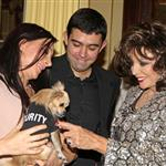 Joan Collins blessing puppies  51531