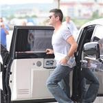 Simon Cowell wears heels like tom Cruise to London X Factor auditions 63711