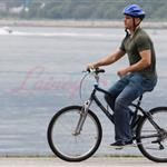 A bald Matt Damon bikes with family in Vancouver  90291