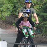 A bald Matt Damon bikes with family in Vancouver  90292