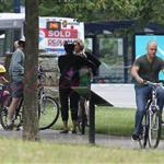 A bald Matt Damon bikes with family in Vancouver  90297