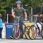 A bald Matt Damon bikes with family in Vancouver  90309