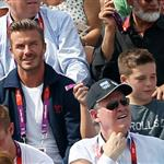 David Beckham and his son Brooklyn watch the racing on Day 14 of the London 2012 Olympic Games at the BMX Track 123044
