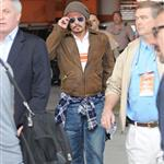 Johnny Depp and Vanessa Paradis take their kids to Miami Dolphins game  75354