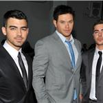 Zac Efron poses with Kellan Lutz and Joe Jonas at Calvin Klein NY Fashion Week  79153