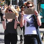 Emma Stone and Andrew Garfield hold up signs when out and about on the streets of NYC 126458