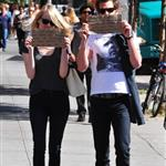 Emma Stone and Andrew Garfield hold up signs when out and about on the streets of NYC 126460