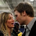 Tom Brady of the New England Patriots gets a hug from his wife Gisele Bundchen after losing to the New York Giants 105026