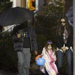 Katie Holmes and Connor Cruise take Suri trick or treating  97427