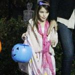 Katie Holmes and Connor Cruise take Suri trick or treating  97429