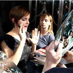 Emma Watson is swarmed by fans as she leaves her London hotel July 2011 89305