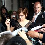 Emma Watson is swarmed by fans as she leaves her London hotel July 2011 89306