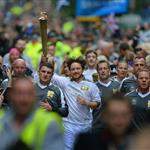 James Mcavoy runs down Buchanan Street carrying the Olympic Torch during the leg between Stranrear and Glasgow 116979
