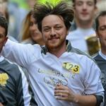 James Mcavoy runs down Buchanan Street carrying the Olympic Torch during the leg between Stranrear and Glasgow 116980