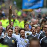 James Mcavoy runs down Buchanan Street carrying the Olympic Torch during the leg between Stranrear and Glasgow 116986