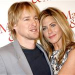 Jennifer Aniston wears print in Paris with Owen Wilson at Marley & Me photo call 33850