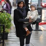 Jessica Alba wears Prada boots with Honor in the rain in LA 53794