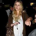 Jessica Simpson tries to hide ring but not really as she and Eric Johnson arrive in New York 73401