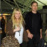 Jessica Simpson tries to hide ring but not really as she and Eric Johnson arrive in New York 73406
