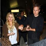 Jessica Simpson tries to hide ring but not really as she and Eric Johnson arrive in New York 73407