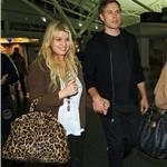 Jessica Simpson tries to hide ring but not really as she and Eric Johnson arrive in New York 73408