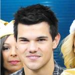 Taylor Lautner on the field at the Saints game  75420
