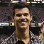 Taylor Lautner on the field at the Saints game  75422