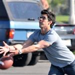 Kevin and Joe Jonas play football between Chasing the Butterfiles shoots 55356