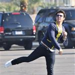 Kevin and Joe Jonas play football between Chasing the Butterfiles shoots 55360