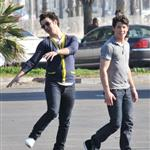 Kevin and Joe Jonas play football between Chasing the Butterfiles shoots 55361