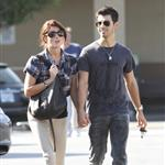 Ashley Greene Joe Jonas holding hands while photos are being taken  69966