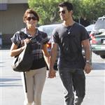 Ashley Greene Joe Jonas holding hands while photos are being taken  69968