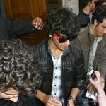 Jonas Brothers in London to promote concert movie 38991