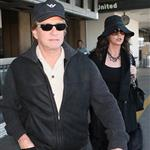 Catherine Zeta-Jones and Michael Douglas arrive at LAX looking old and rich 34397