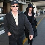 Catherine Zeta-Jones and Michael Douglas arrive at LAX looking old and rich 34396