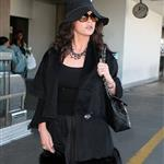 Catherine Zeta-Jones and Michael Douglas arrive at LAX looking old and rich 34395