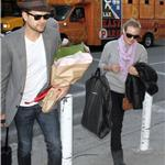 Joshua Jackson greets Diane Kruger at LAX on Valentine's Day with flowers  79213