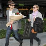 Joshua Jackson greets Diane Kruger at LAX on Valentine's Day with flowers  79214