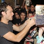 Jude Law signs autographs for young fans after a Hamlet performance for students  43047