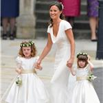 Sister of the bride and Maid of Honour Pippa Middleton holds hands with Grace Van Cutsem and Eliza Lopes as they arrive for the Royal Wedding 84055