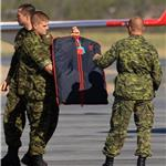 Canadian soldiers load Prince William and Catherine's luggage onto the Royal Plane in Yellowknife  89332