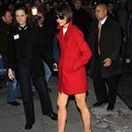 Katie Holmes wearing short skirt and red coat on her way to Letterman 16311
