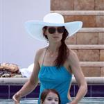 Katie Holmes with Suri by the pool in Miami  85549