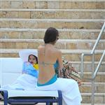 Katie Holmes with Suri by the pool in Miami  85550