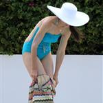 Katie Holmes with Suri by the pool in Miami  85552